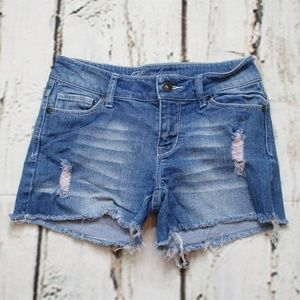 dELiA*s Taylor Cut Off Distressed Low Rise Shorts